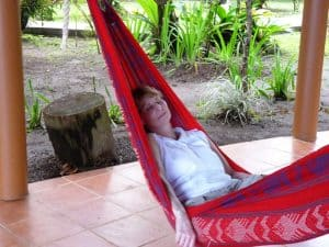 girl sleeping in red hammock