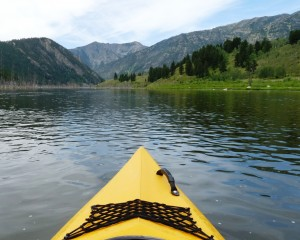 Front tip of kayak pointing to the distance mountain on a clear day