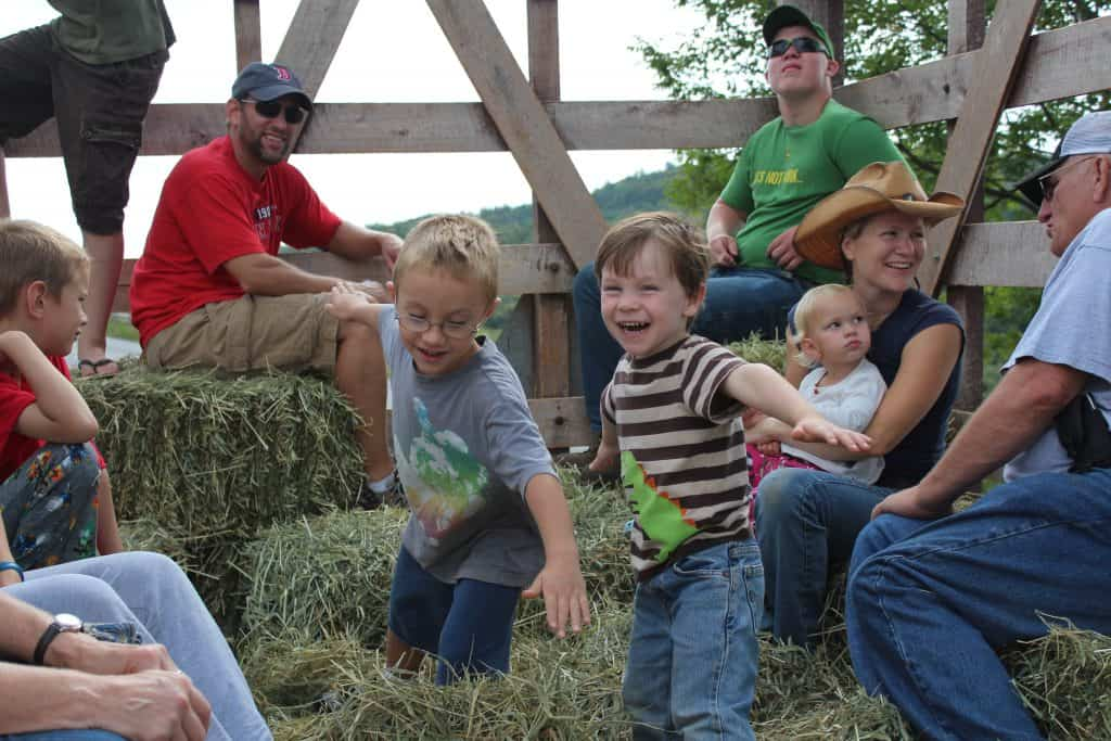 Children laughing and having fun on a hayride